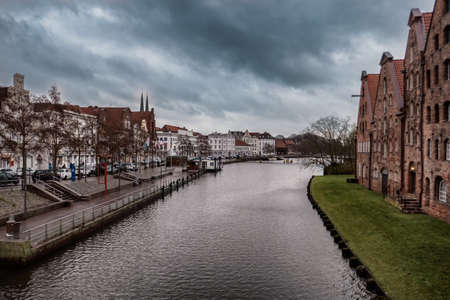 Vintage trading houses by the river in Lübeck, Germany