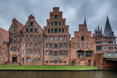 Vintage trading houses by the river in Lübeck, Germany Banco de Imagens - 93497036