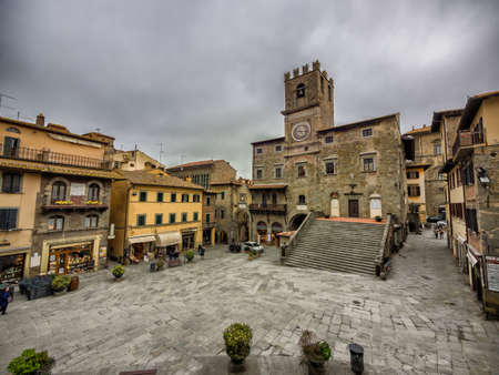 Main square with city hall in Cortona, Tuscany Italy