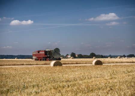 Harvester on a field of barley on Hjarnoe Jutland, Denmark