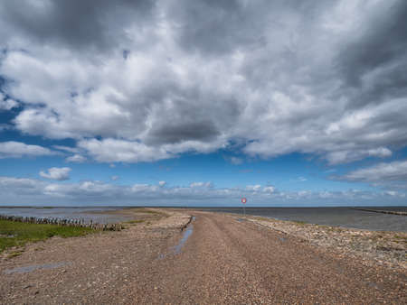 Wadden sea road to the island Mandoe in Denmark Stock Photo - 127816319
