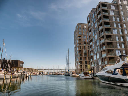 Vejle inner marina harbor with modern apartments and small boats, Denmark Stockfoto