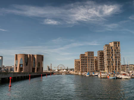 Vejle inner marina harbor with modern apartments and small boats, Denmark