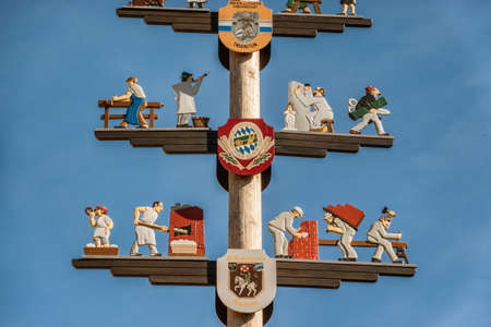 Pole with coat of arms in Traunsten, Bavaria, Germany