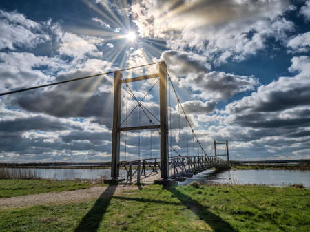Kong Hans suspension  bridge in Skjern meadows Ringkoebing, Denmark