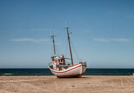 Coastal fishing boats on the beach at SletteStrand at the North Sea in Denmark Stock fotó