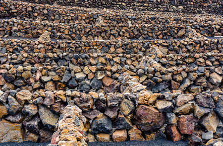 Several natural stone walls behind the other, Lanzarote, Spain Banco de Imagens