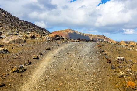 Gravel track in the Caldera Colorada, Lanzarote, Canary islands, Spain Banco de Imagens