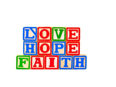 The words FAITH, HOPE and LOVE spelled out using some old alphabet blocks. Stock Photo - 4268580