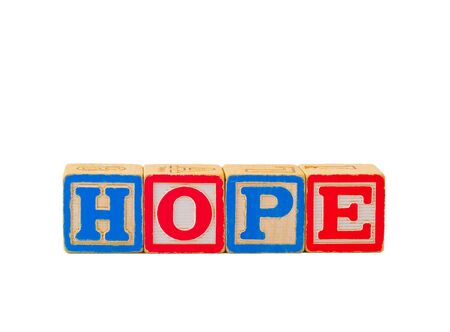 The word HOPE spelled out using some old alphabet blocks.