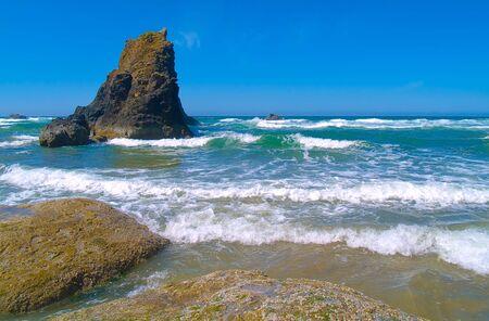 Arcadia Beach on the Northern Oregon Coast on a clear sunny summer day.  photo