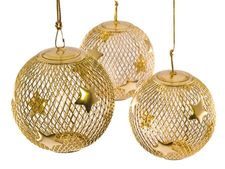 wire mesh: A hollow gold wire mesh Christmas ornament with stars.
