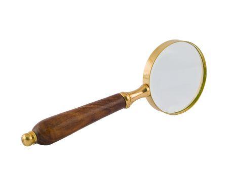 真鍮、白で隔離される木製の虫眼鏡。