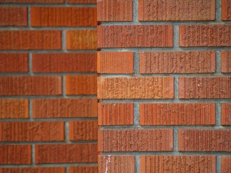 regular: Brick wall backgrounds, all in good repair,  in various shades of red, orange, brown, tan, and white.      Stock Photo