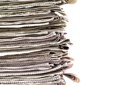 Old newspapers stacked from the top to bottom of the frame isolated on white.