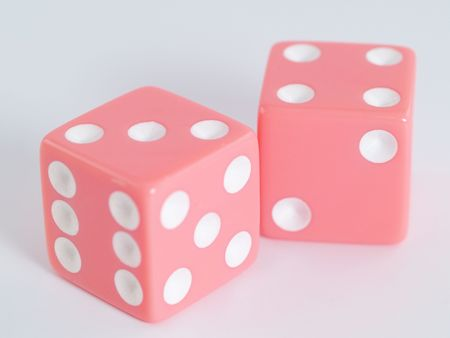Two pink dice with white dots with 7 showing.