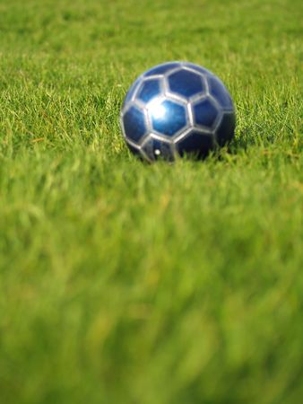 A blue soccer ball on a field of green grass on a bright, sunny day Stock Photo - 5000243