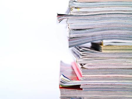 An uneven stack of magazines filling the frame from top to bottom with copyspace on left Stock Photo - 5061797