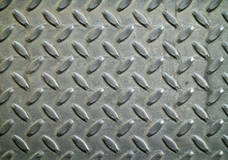 metal grid: Diamond metal background texture illuminated by sunlight