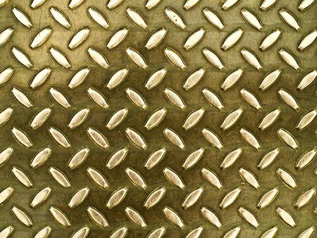 Diamond gold toned metal background texture illuminated by sunlight photo