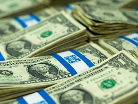 Hundred dollar bundles of U.S. One Dollar bill laid out as a background Stock Photo