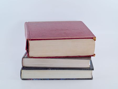 Old Textbooks stacked on a blank background photo