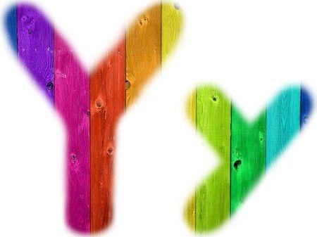 De letter Y met een houten regenboog achtergrond
