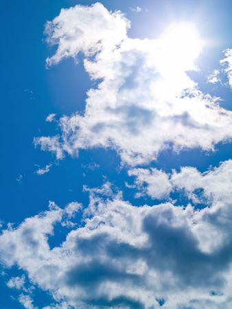 clear day: Sun in the sky with white clouds Stock Photo