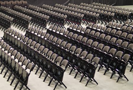 Folding chairs in row in a large stadium photo