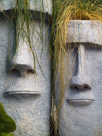 planters: Easter Island planters with long grean and yellow grass hair