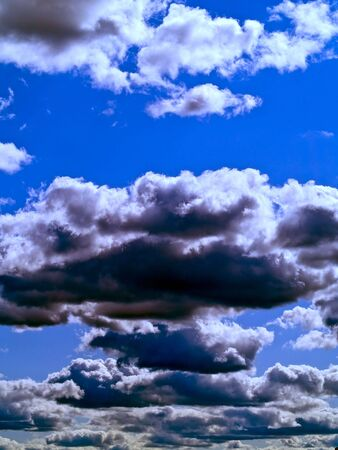 Gray and white clouds on a blue sky