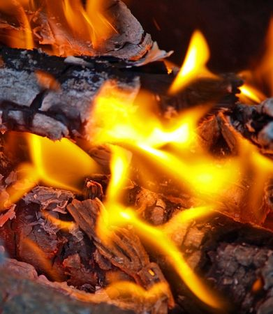 embers: Flames in a fire pit with glowing embers