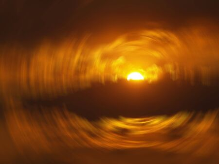 Golden sun and clouds in an abstract event horizon photo