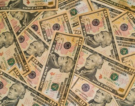 A background of US $10 Dollar Bills photo