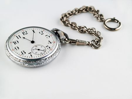 hands in  pocket: Silver Pocket Watch on a chain isolated on Gray Stock Photo