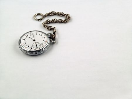 Silver Pocket Watch on a chain isolated on Gray photo