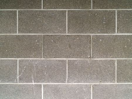 グレーと白の軽量コンクリート ブロック壁の背景 写真素材