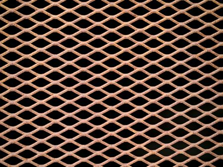 Rusted metal grate securing a tunnel hole photo