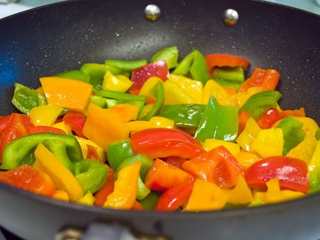 Frying red, green and yellow bell peppers photo