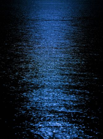 Moon light reflection on calm but rippled water