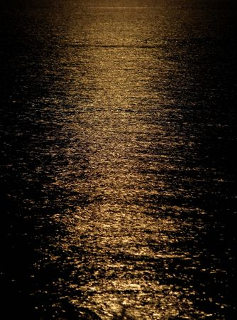 Moon light reflection on calm but rippled water Stock Photo - 6338724