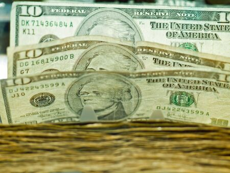 An electronic money counter processing US $10 bills photo