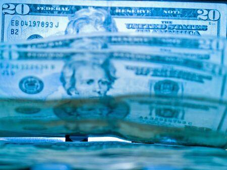 An electronic money counter processing US $20 bills Banco de Imagens