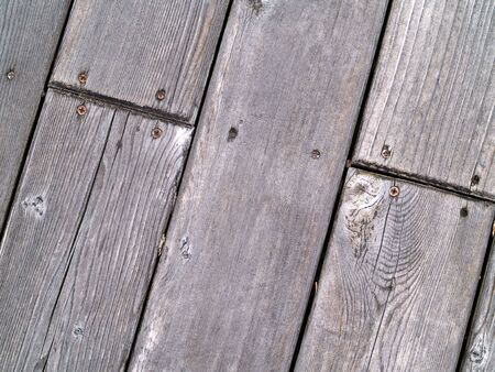 Wood Deck Close Up with Wood Grain and Screws photo