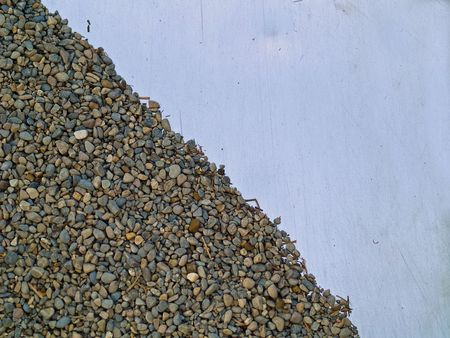 Pea Gravel on a Metal Slide in a Playground photo