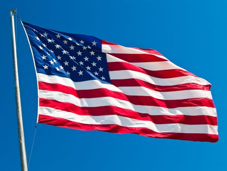 American Flag Waving Proudly on a Clear Windy Day photo