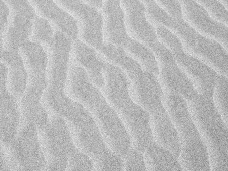 Abstract background of white sand ripples at the beach photo