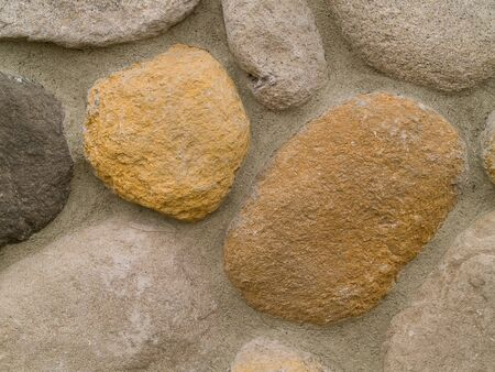 Rock and Concrete Wall with Large Rounded Stones photo