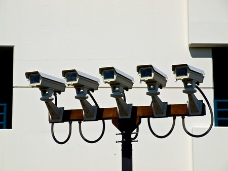Group of Five Security Cameras Performing Surveillance  photo