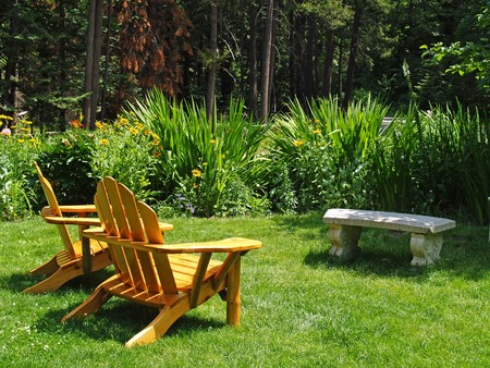 adirondack chair: Empty Adirondack Chairs in an Green Park Stock Photo